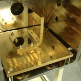 CUSTOM PLATEN AND FIXTURING: HIGH VACUUM ASSISTED MANUFACTURE AND TEST STATION