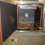 CUSTOM PLATEN AND SHROUD SYSTEM IN HIGH VACUUM (10E-6 TORR) CHAMBER