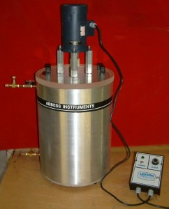 Economy 5-Gallon aluminum round vacuum chamber with an electric mixer