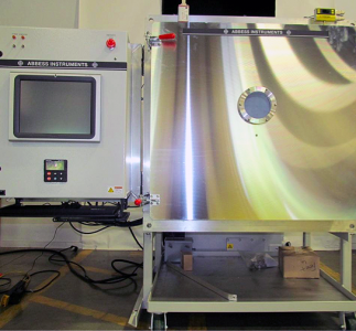 Front view of full vacuum chamber system with touch screen controls.