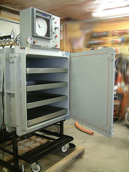 Heated Vacuum Drying chamber with built in shelves and customer specified control system.