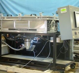 "A thermal vacuum chamber shown with 3 Copper Thermal Plate with 2""x 2"" matrix with 1/4"" x 20 threaded holes, and with optional electronic ports, TC type K feedthrus, lights, cart, pump, filters/traps and windows."