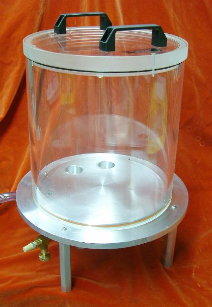 Round vacuum chamber with base plate, similar to a bell jar