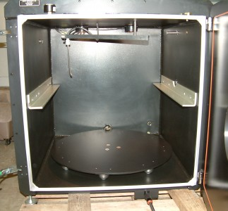 Turn table within a PTFE non-stick coating coated chamber