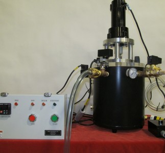 Nonstick PFE coated round vacuum chamber with motorized mixing and automated controls.