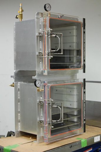 Front side view of two cubes with custom door latch assembly